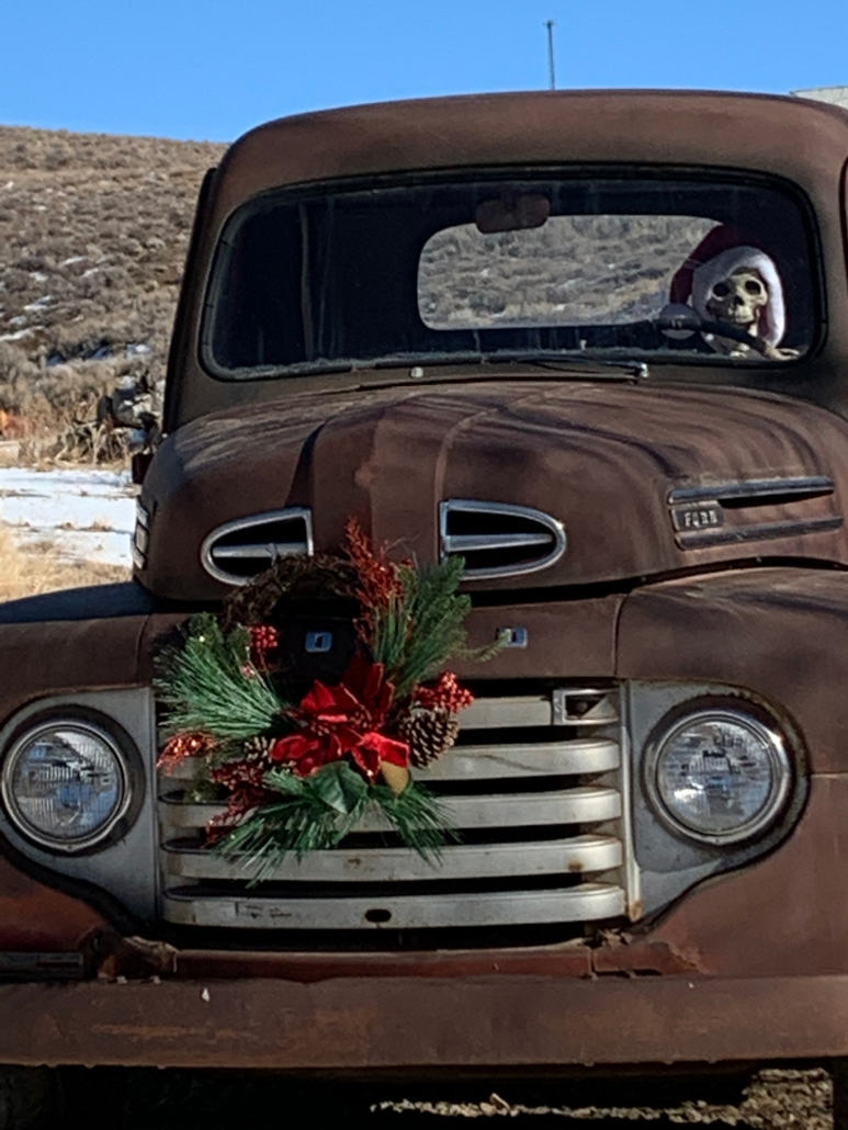 """Parked at the entrance to the Midas Park is a 1941 Ford pickup that was used on the Pinson Ranch. It was donated to Friends of Midas by Vic Christison. The driver is a local """"resident"""" who changes hats with the seasons."""
